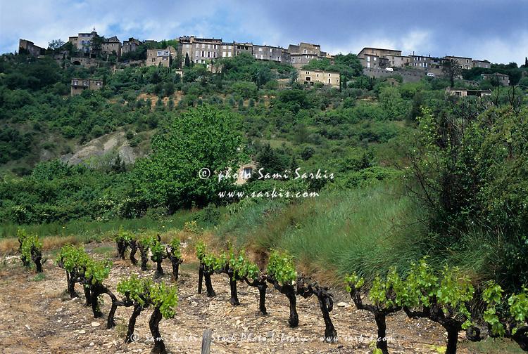 Quaint village on a hill above a vineyard, Gordes, Vaucluse, Provence, France.