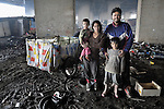 """THIS PHOTO IS AVAILABLE AS A PRINT OR FOR PERSONAL USE. CLICK ON """"ADD TO CART"""" TO SEE PRICING OPTIONS.   Nevrigda Zitkova and her husband Arden Dasi, with two of their children, live under a bridge in a Roma settlement in Belgrade, Serbia. Refugees from Kosovo, they survive from recycling cardboard and other materials. The community is under constant threat of eviction by city officials."""