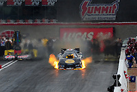 Apr. 2, 2011; Las Vegas, NV, USA: NHRA funny car driver Brian Thiel blows an engine in flames during qualifying for the Summitracing.com Nationals at The Strip in Las Vegas. Mandatory Credit: Mark J. Rebilas-
