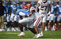 Arkansas defensive back Jalen Catalon (1) tackles Ole Miss wide receiver Dontario Drummond (11), Saturday, October 9, 2021 during the fourth quarter of a football game at Vaught Hemingway Stadium in Oxford, Miss. Check out nwaonline.com/211010Daily/ for today's photo gallery. <br /> (NWA Democrat-Gazette/Charlie Kaijo)