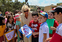 Pictured: The Duchess of Cornwall is surrounded by local school children at Knossos on the island of Crete, Greece. Friday 11 May 2018 <br /> Re:HRH Prnce Charles and his wife the Duchess of Cornwall visit the ancient site of Knossos near Heraklion, Greece.