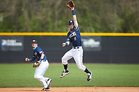 Queens Royals shortstop Nick Melton (28) leaps for a high throw during the game against the Catawba Indians during game one of a double-header at Tuckaseegee Dream Fields on March 26, 2021 in Kannapolis, North Carolina. (Brian Westerholt/Four Seam Images)