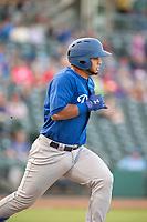 Tulsa Drillers catcher Keibert Ruiz (27) runs for first on May 13, 2019, at Arvest Ballpark in Springdale, Arkansas. (Jason Ivester/Four Seam Images)