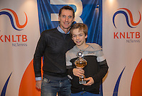 Hilversum, Netherlands, December 4, 2016, Winter Youth Circuit Masters 2 nd  place boys 14 years Stian Klaassen with Fedcup  captain Paul Haarhuis.<br /> Photo: Tennisimages/Henk Koster