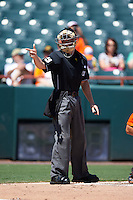 Umpire Junior Valentine makes a call during a game between the Reading Fightin Phils and Bowie Baysox on July 22, 2015 at Prince George's Stadium in Bowie, Maryland.  Bowie defeated Reading 6-4.  (Mike Janes/Four Seam Images)