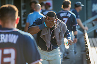 Northwest Arkansas Naturals outfielder Dairon Blanco (15) splashes water on his face in the dugout during the game against the Wichita Wind Surge at Riverfront Stadium on July 9, 2021in Wichita, Kansas. (William Purnell/Four Seam Images)