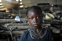 Sierra Leone, Freetown, girl sells firewood