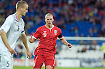 Steve Morison of Wales challenges Norway Captain Brede Hangeland during the .Wales v Norway Vauxhall international friendly match at the Cardiff City Stadium in South Wales..Editorial use only.