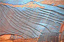 GEOLOGICAL ROCK STRIATIONS ON SANDSTONE WALL