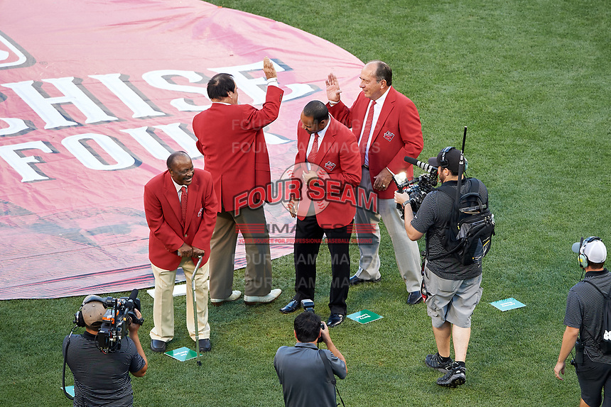Pete Rose high fives Johnny Bench as Joe Morgan and Barry Larkin look on during the Franchise Four introductions before the MLB All-Star Game on July 14, 2015 at Great American Ball Park in Cincinnati, Ohio.  (Mike Janes/Four Seam Images)