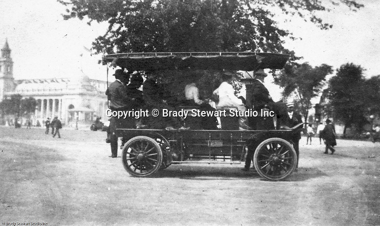 """Client: St Louis Exhibition<br /> Product: Transport carrier<br /> Manufacturer: St Louis Car Company<br /> <br /> St Louis MO:  A view of one of the many """"new"""" buses used to transport the millions of visitors around the exposition.  The palace of Varied Industries is in the background"""