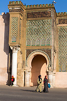 Meknes, Morocco.  Two Women Walking in front of the Bab Mansour, built 1672-1732.