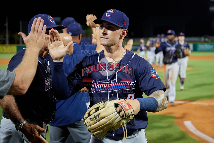 Jacksonville Jumbo Shrimp John Silviano (8) high fives with his teammates after a game against the Pensacola Blue Wahoos on August 15, 2018 at Blue Wahoos Stadium in Pensacola, Florida.  Jacksonville defeated Pensacola 9-2.  (Mike Janes/Four Seam Images)