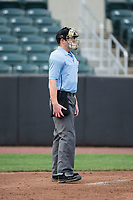 Home plate umpire Chad Dixon works the plate during the New York Penn League game between the Hudson Valley Renegades and the Aberdeen IronBirds at Leidos Field at Ripken Stadium on July 27, 2017 in Aberdeen, Maryland.  The Renegades defeated the IronBirds 2-0 in game one of a double-header.  (Brian Westerholt/Four Seam Images)