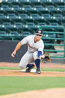 Charleston RiverDogs first baseman Mike Ford (26) stretches for a throw during the game against the Hickory Crawdads at L.P. Frans Stadium on June 2, 2014 in Hickory, North Carolina.  The Crawdads defeated the RiverDogs 9-6.  (Brian Westerholt/Four Seam Images)
