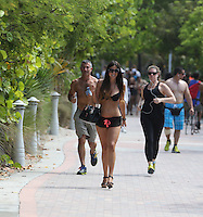 APRIL 27 2013.SEXY GLAMOUR MODEL CLAUDIA ROMANI IN MIAMI BEACHES UNDER FLORIDA SUN.Non Exclusive.Mandatory Credit: OHPIX.COM..Ref: OH_SOL