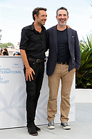 """CANNES, FRANCE - JULY 17: Nicolas Bedos and Jean Dujardin at photocall for the film """"OSS 117 : Alerte Rouge en Afrique Noire"""" (OSS 117 : From Africa With Love) at the 74th annual Cannes Film Festival in Cannes, France on July 17, 2021 <br /> CAP/GOL<br /> ©GOL/Capital Pictures"""