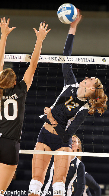 SIOUX FALLS, SD - SEPTEMBER 18:  Holly Hafemeyer #12 from Augustana winds up for a kill attempt against Alex Armes #10 from Wayne State in the second match of their game Tuesday night at Augustana. (Photo by Dave Eggen/Inertia)