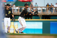 Pittsburgh Pirates shortstop Pedro Florimon (17) throws to first as Max Moroff (71) looks on during a Spring Training game against the Toronto Blue Jays  on March 3, 2016 at McKechnie Field in Bradenton, Florida.  Toronto defeated Pittsburgh 10-8.  (Mike Janes/Four Seam Images)