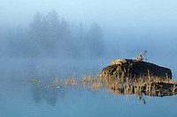 """""""Mystical Morning""""<br /> <br /> The fog slowly gives way at golden hour, painting another mystical morning on the North Kawishiwi River in Boundary Waters Canoe Area Wilderness (BWCAW)."""