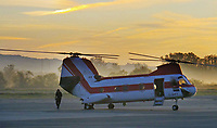 A Boeing Vertol CH-46 Sea Knight twin rotor helicopter based in British Columbia, Canada prepares for takeoff at dawn at the Petaluma Municipal Airport, Petaluma, Sonoma County, California.