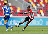 20th March 2021; Brentford Community Stadium, London, England; English Football League Championship Football, Brentford FC versus Nottingham Forest; Ivan Toney of Brentford taking a shot past Tobias Figueiredo of Nottingham Forest  before the full time whistle but the shot goes wide