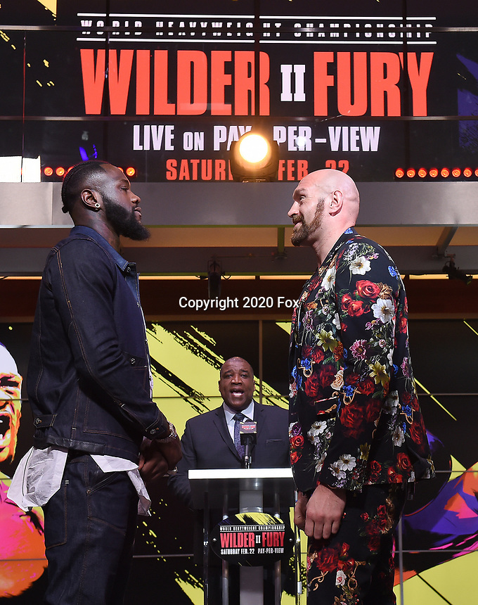 """LOS ANGELES - JANUARY 25: Curt Menefee introduces Deontay Wilder and Tyson Fury during a Los Angeles press conference on January 25, 2020 for the """"Wilder vs Fury II"""" FOX SPORTS PPV & ESPN+ PPV which will take place on Feb. 22 from the MGM Grand Garden Arena in Las Vegas. (Photo by Frank Micelotta/Fox Sports/PictureGroup)"""