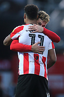 Brentford's Emiliano Marcondes and Ollie Watkins celebrate their victory at the final whistle during Brentford vs Middlesbrough, Sky Bet EFL Championship Football at Griffin Park on 8th February 2020