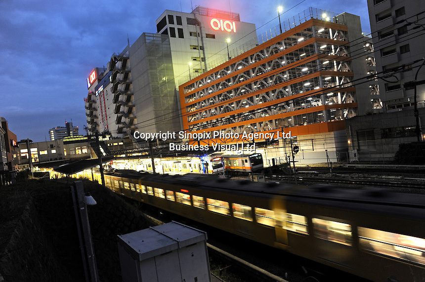 Trains pass a typical buildings in Tokyo. Tokyo is the most populated metropolitan area with 35 million people.<br /> <br /> <br /> Richard Jones  /  Sinopix