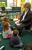 MR / Schenectady, NY.Yates Arts-in-Education Magnet School, Grade 2.Arts-Themed Urban Elementary School.Teacher teaches reading lesson using teacher's edition of reading book series..MR: Car19   g2c.© Ellen B. Senisi