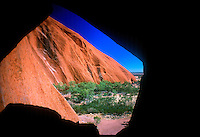 Portion of Ayers Rock view from a small cave that is given the impression of the shape or Map of Australia.