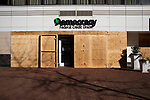 Plywood covers Democracy Federal Credit Union ahead of President-Elect Joe Biden's Inauguration on January 19, 2021 in Washington, D.C..  Photograph by Michael Nagle