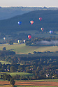 Hot air balloons viewed from Curbar Edge, Peak District National Park, Derbyshire, UK.