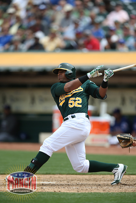 OAKLAND, CA - MAY 15:  Yoenis Cespedes #52 of the Oakland Athletics bats during the game against the Texas Rangers at O.co Coliseum on Wednesday May 15, 2013 in Oakland, California. Photo by Brad Mangin
