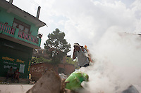 A man carries a bag of rice on his back . Shankhu city, near Kathmandu, Nepal. May 13, 2015