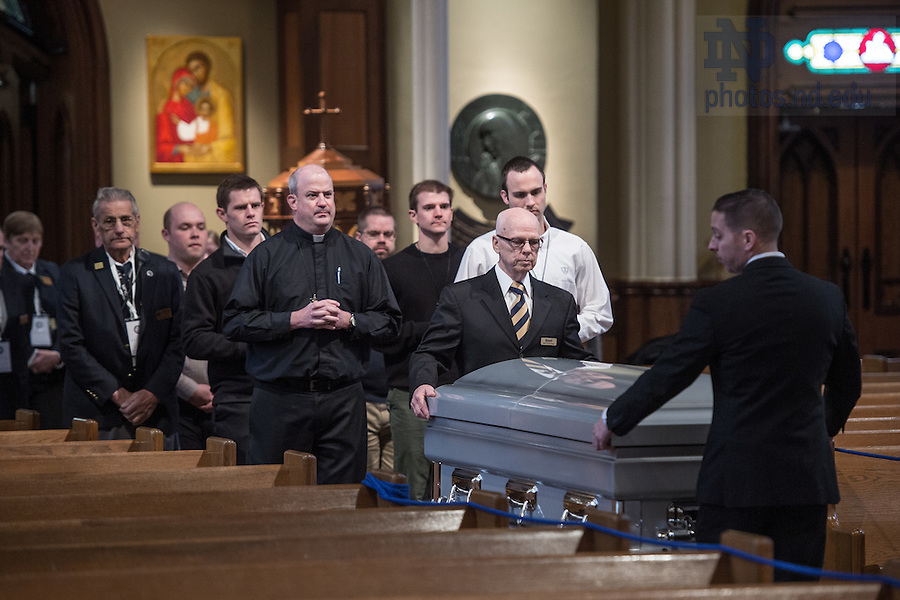 Mar. 3, 2015; Rev. Peter Jarret, C.S.C., religious superior of Holy Cross priests and brothers at Notre Dame, follows the casket of President Emeritus Rev. Theodore M. Hesburgh, C.S.C. into the Basilica of the Sacred Heart for the visitation and wake. (Photo by Matt Cashore/University of Notre Dame)