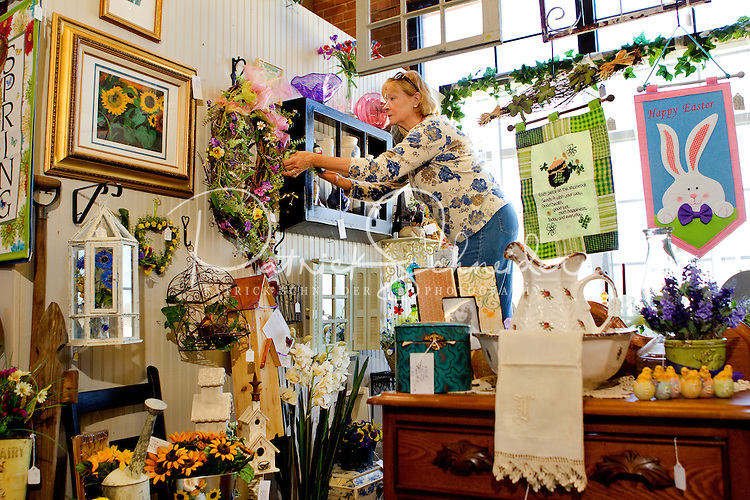 Vender Susan Renaghan with As Good As It Gets, works to restock his inventory inside his booth at the Depot at Gibson Mill, an antique and designer mall that was once a mill, located in Concord, N.C. With 85,000 square feet and 460 booths, the antique mall is one of the largest antique and designer mall in the South..Once a part of the old Cannon Mills, the charm of the 20 foot ceilings, wide wooden floors and exposed brick remains. Photo is part of a photographic series of images featuring Concord, NC, by Charlotte-based photographer Patrick Schneider..