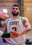 12 March 2019: University of Vermont Catamount Forward Anthony Lamb, a Junior from Toronto, Ontario, returns to the bench in the second half of play against the Binghamton University Bearcats at Patrick Gymnasium in Burlington, Vermont. Lamb finished the game with 18 points and a career-high seven assists as the top-seeded Catamounts advanced to their fourth-straight America East conference championship game, defeating the Bearcats 84-51. Mandatory Credit: Ed Wolfstein Photo *** RAW (NEF) Image File Available ***