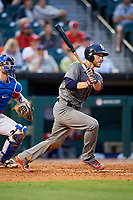 Lehigh Valley IronPigs catcher Logan Moore (35) follows through on a swing in front of catcher Danny Jansen (9) during a game against the Buffalo Bisons on June 23, 2018 at Coca-Cola Field in Buffalo, New York.  Lehigh Valley defeated Buffalo 4-1.  (Mike Janes/Four Seam Images)