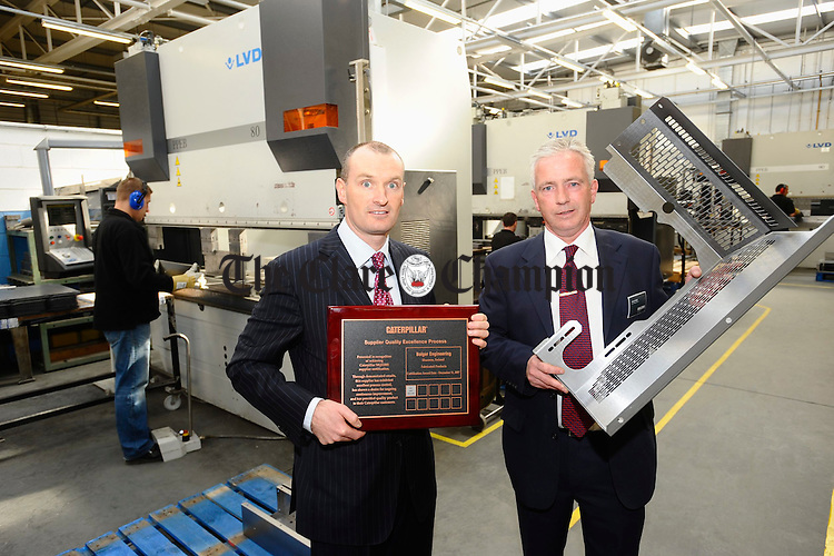 Ian and Graham Bolger, joint managing directors of Bolgers, Smithstown, Shannon, pictured at the presentation of the Silver Certificate for Caterpillar's Supplier Quality Excellence Process to the company. Photograph by John Kelly.