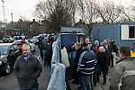 Glossop North End 0 Barnoldswick Town 1, 19/02/2011. Surrey Street, North West Counties League Premier Division. Spectators making their way out of the Surrey Street ground after watching Glossop North End's fixture against Barnoldswick Town in the Vodkat North West Counties League premier division. The visitors won the match by one goal to nil watched by a crowd of 203 spectators. Glossop North End celebrated their 125th anniversary in 2011 and were once members of the Football League in England, spending one season in the top division in 1899-00. Photo by Colin McPherson.