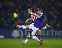 Exeter City's Dara O'Shea, left, and Pierce Sweeney deny Lincoln City's John Akinde<br /> <br /> Photographer Andrew Vaughan/CameraSport<br /> <br /> The EFL Sky Bet League Two - Lincoln City v Exeter City - Tuesday 26th February 2019 - Sincil Bank - Lincoln<br /> <br /> World Copyright © 2019 CameraSport. All rights reserved. 43 Linden Ave. Countesthorpe. Leicester. England. LE8 5PG - Tel: +44 (0) 116 277 4147 - admin@camerasport.com - www.camerasport.com