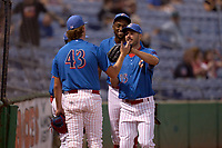 Philadelphia Phillies Matt Joyce (35), on rehab assignment with the Clearwater Threshers, high fives pitcher J.P. Woodward (43) after making a play during a game against the Dunedin Blue Jays on May 18, 2021 at BayCare Ballpark in Clearwater, Florida.  (Mike Janes/Four Seam Images)