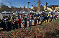 STAFF PHOTO BEN GOFF  @NWABenGoff -- 11/25/14 Demonstrators share speeches and stories during a protest organized by the OMNI Center for Peace, Justice & Ecology in front of the Washington County Courthouse in Fayetteville on Tuesday Nov. 25, 2014. Four demonstrators volunteered to make a statement by being arrested. The demonstration was in response to the decision Monday night by the St. Louis County grand jury not to indict police officer Darren Wilson, who fatally shot Michael Brown in Ferguson, Mo.