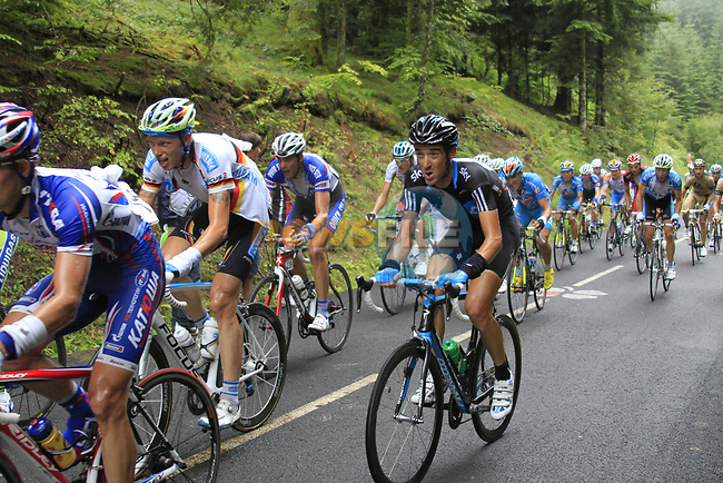 The peloton including Michael Barry (CAN) Sky Pro Cycling approach the summit of the Cat 1 climb at Col du Marie Blanque during a wet foggy Stage 17 of the 2010 Tour de France running 174km from Pau to Col du Tourmalet, France. 22nd July 2010.<br /> (Photo by Eoin Clarke/NEWSFILE).<br /> All photos usage must carry mandatory copyright credit (© NEWSFILE | Eoin Clarke)