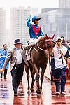 Jockey Joao Moreira riding Rapper Dragon celebrates winning the 2017 BMW Hong Kong Derby Race at the Sha Tin Racecourse on 19 March 2017 in Hong Kong, China. Photo by Marcio Rodrigo Machado / Power Sport Images