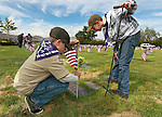 Garrett Van Roy, left, and Tyler Roach, both 11, place flags on the graves of veterans at the Lone Mountain Cemetery in Carson City, Nev., on Friday, May 25, 2012. Volunteers from the D.A.V., American Legion, Carson High School ROTC and Boy Scout Troop 145 placed more than 1,400 flags on the graves of veterans in honor of Memorial Day..Photo by Cathleen Allison