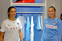 Chicago Red Stars players Carli Lloyd and Nikki Krzysik stand by their locker during the unveiling of the Women's Professional Soccer uniforms at the Event Place in Manhattan, NY, on February 24, 2009. Photo by Howard C. Smith/isiphotos.com