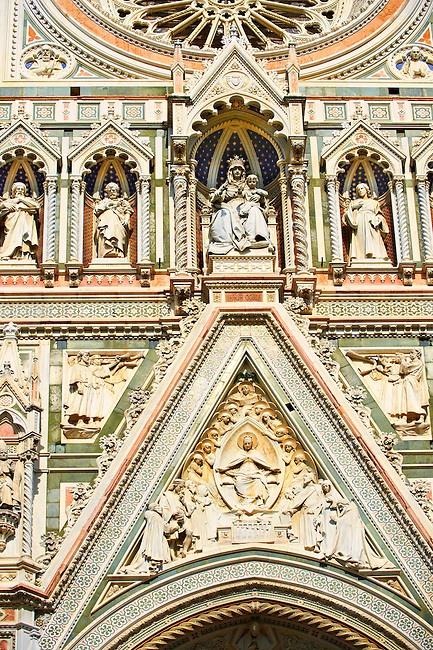 Statues of the Virgin Mary flanked by the Apostles and the  the fine Gothic architectural detail of  the  of the Gothic-Renaissance Duomo of Florence,  Basilica of Saint Mary of the Flower; Firenza ( Basilica di Santa Maria del Fiore ).  Built between 1293 & 1436. Italy