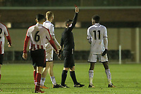 Pictured: Jordon Garrick sees a red card by referee Savvas Yianni. Wednesday 20 December 2017<br /> Re: Premier League International Cup, Swansea City U23 v Athletic Bilbao at the Landore Training Ground, Swansea, Wales, UK.